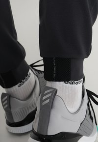 adidas Golf - ADICROSS RANGE JOGGER PANTS - Tracksuit bottoms - carbon - 6