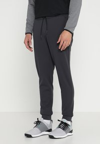 adidas Golf - ADICROSS RANGE JOGGER PANTS - Tracksuit bottoms - carbon - 0
