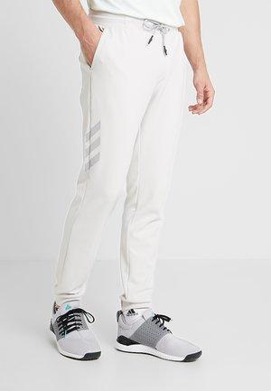 ADICROSS RANGE JOGGER PANTS - Bukser - raw white