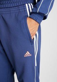 adidas Golf - STRIPE COLLECTION DOBBY PANT - Træningsbukser - tech indigo - 5