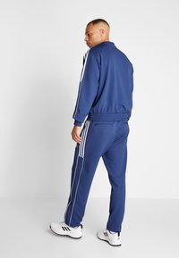 adidas Golf - STRIPE COLLECTION DOBBY PANT - Træningsbukser - tech indigo - 2
