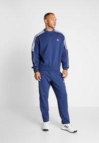 adidas Golf - STRIPE COLLECTION DOBBY PANT - Træningsbukser - tech indigo - 1