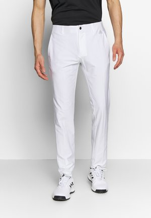 ULTIMATE TAPERED PANT - Pantalones - white