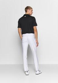 adidas Golf - ULTIMATE TAPERED PANT - Kangashousut - white - 2