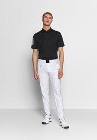 adidas Golf - ULTIMATE TAPERED PANT - Kangashousut - white - 1