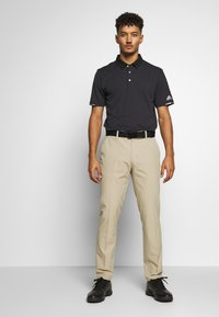 adidas Golf - ULTIMATE TAPERED PANT - Kalhoty - raw gold - 1