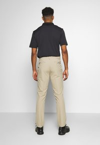 adidas Golf - ULTIMATE TAPERED PANT - Kalhoty - raw gold - 2