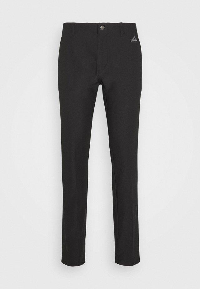 ULTIMATE SPORTS GOLF PANTS - Spodnie materiałowe - black
