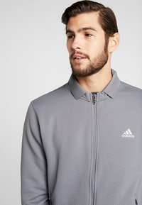 adidas Golf - CLIMAHEAT JACKET - Treningsjakke - grey four - 3