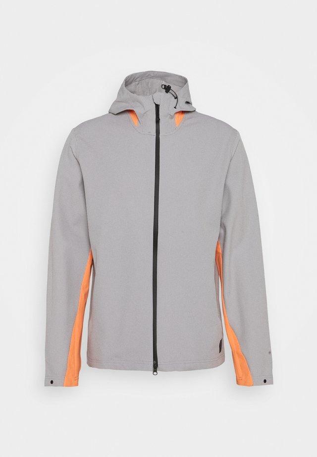 ADICROSS ELEMENT JACKET - Waterproof jacket - grey three/amber tint