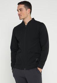adidas Golf - TECH  - Sportovní bunda - black - 0