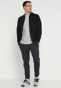 adidas Golf - TECH  - Sportovní bunda - black - 1