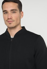 adidas Golf - TECH  - Sportovní bunda - black - 3