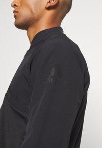 adidas Golf - HYBRID ZIP - Sportovní bunda - black - 6