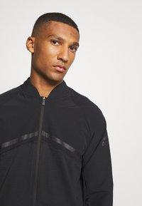 adidas Golf - HYBRID ZIP - Sportovní bunda - black - 3