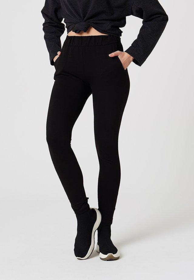PANTALONS DE LOISIRS - Legging - schwarz