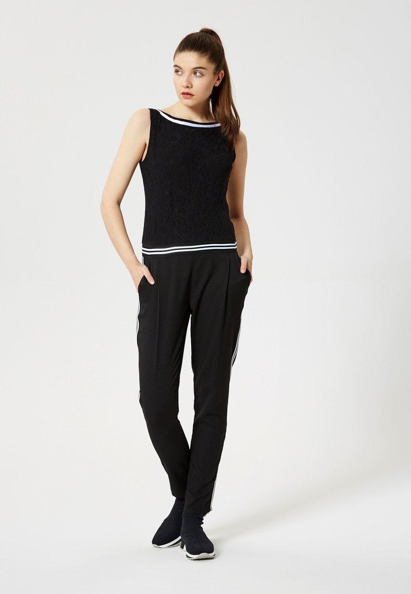 Talence - Jumpsuit - black
