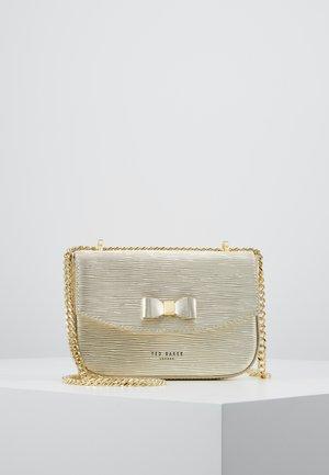 DAISSY - Across body bag - gold