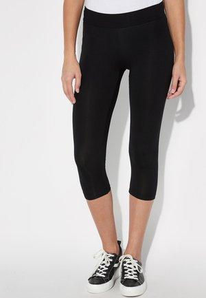 KURZE - Leggings - Trousers - nero