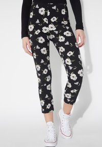 Tezenis - BEDRUCKTE CAPRI - Leggings - Trousers - nero st.magnolia - 0
