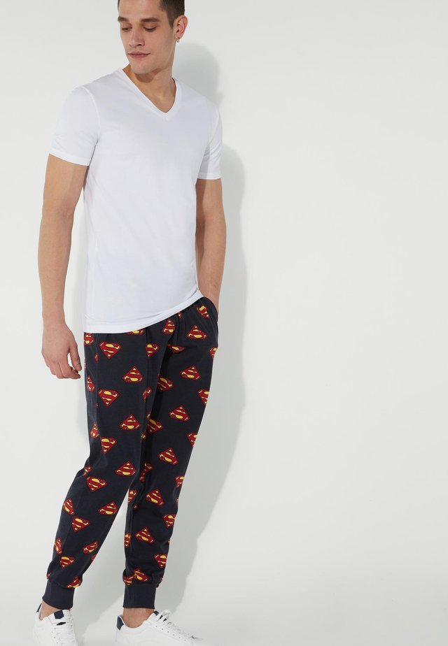 COMICS - Tracksuit bottoms - blu cielo st.superman allover