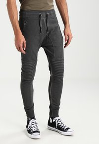 Tigha - TREVOR ZIP - Tracksuit bottoms - vintage grey - 0