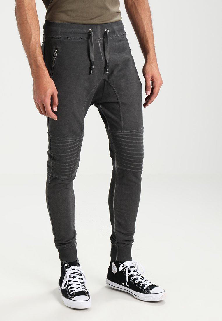 Tigha - TREVOR ZIP - Tracksuit bottoms - vintage grey