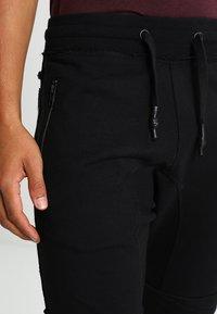 Tigha - TREVOR ZIP - Pantalon de survêtement - black - 3