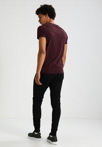 Tigha - TREVOR ZIP - Pantalon de survêtement - black - 2
