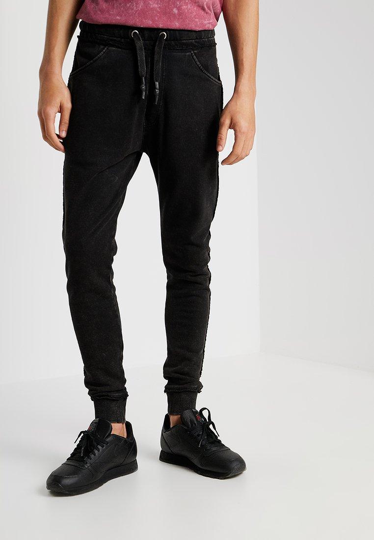 Tigha - GILIAN - Jogginghose - vintage black