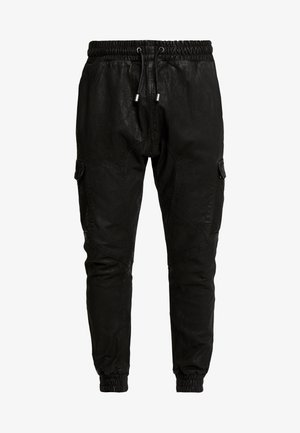 MORLIN - Leather trousers - black