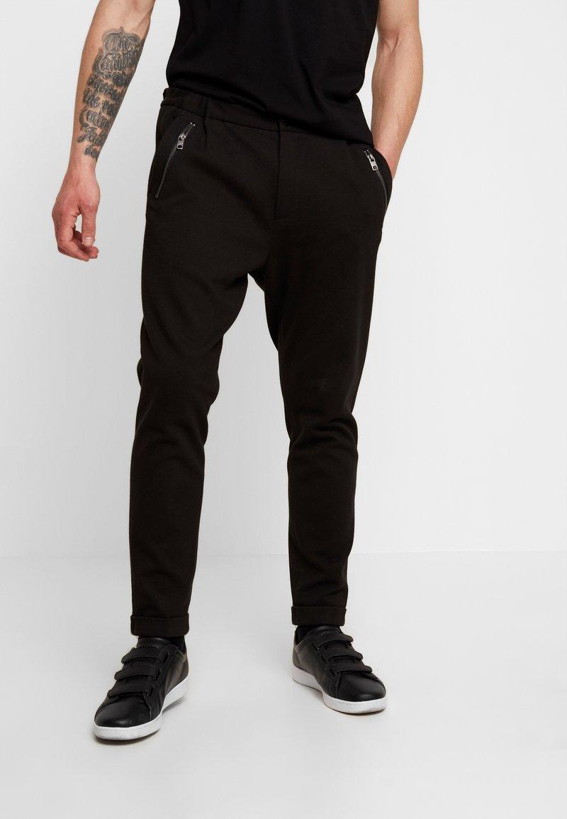 Tigha - ALEKO - Pantalon classique - black