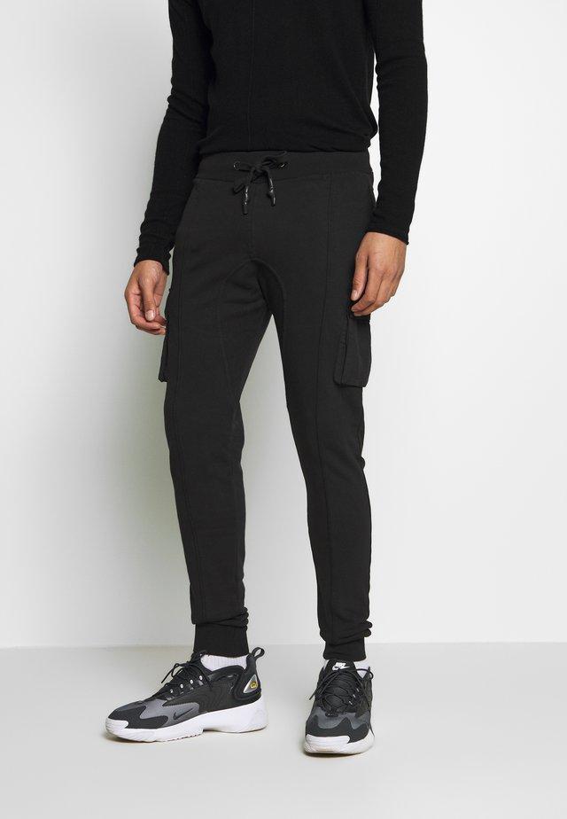 LEONAS - Teplákové kalhoty - black