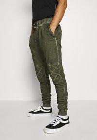 Tigha - EINAR - Teplákové kalhoty - military green - 3