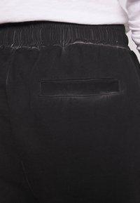 Tigha - EINAR - Tracksuit bottoms - black - 5