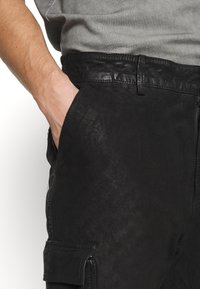 Tigha - ZENO - Spodnie skórzane - black - 4