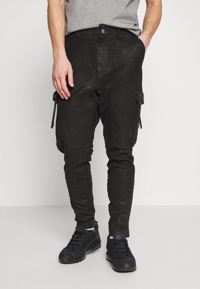 ZENO - Leather trousers - black