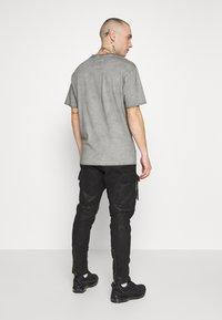 Tigha - ZENO - Spodnie skórzane - black - 2