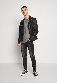 Tigha - BILLY THE KID - Slim fit jeans - dark grey - 1