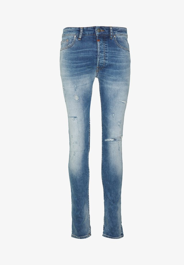 MORTEN PATCHED - Slim fit jeans - light blue