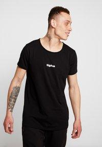 Tigha - JARDEL - T-shirts - black - 0