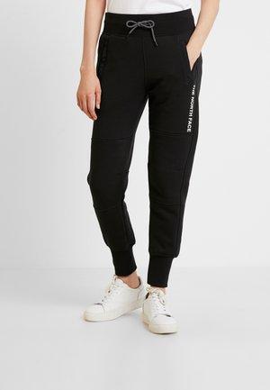 GRAPHIC PANT - Verryttelyhousut - black