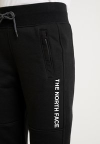 The North Face - GRAPHIC PANT - Verryttelyhousut - black - 3