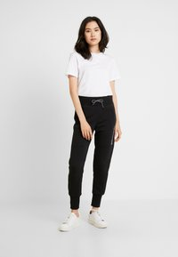 The North Face - GRAPHIC PANT - Träningsbyxor - black - 1