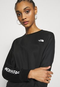 The North Face - TRAIN LOGO CROP - Sweatshirt - black - 3