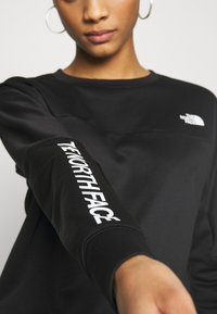 The North Face - TRAIN LOGO CROP - Sweatshirt - black - 5