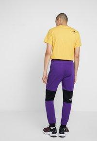 The North Face - HIMALAYAN PANT - Spodnie treningowe - hero purple/black - 2