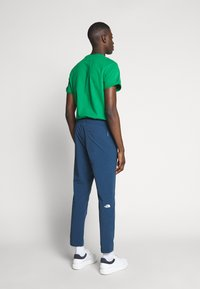 The North Face - TECH PANT - Spodnie treningowe - blue wing teal - 2