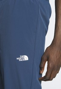 The North Face - TECH PANT - Spodnie treningowe - blue wing teal - 6