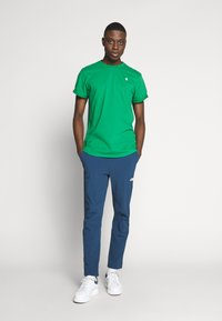 The North Face - TECH PANT - Spodnie treningowe - blue wing teal - 1